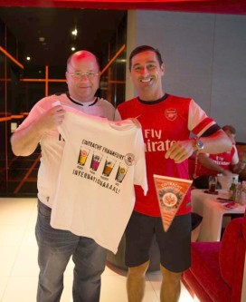 The Bedus give their presents to the Arsenal fan club