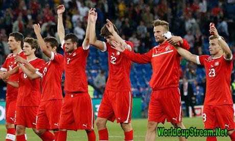 The Switzerland players celebrate after winning their friendly international match against Brazil